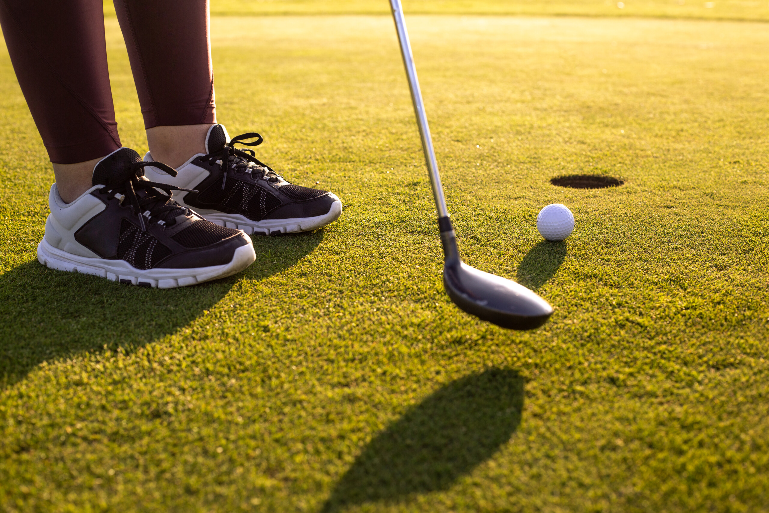 Professional woman golf player playing golf competition / match, professional sport concept