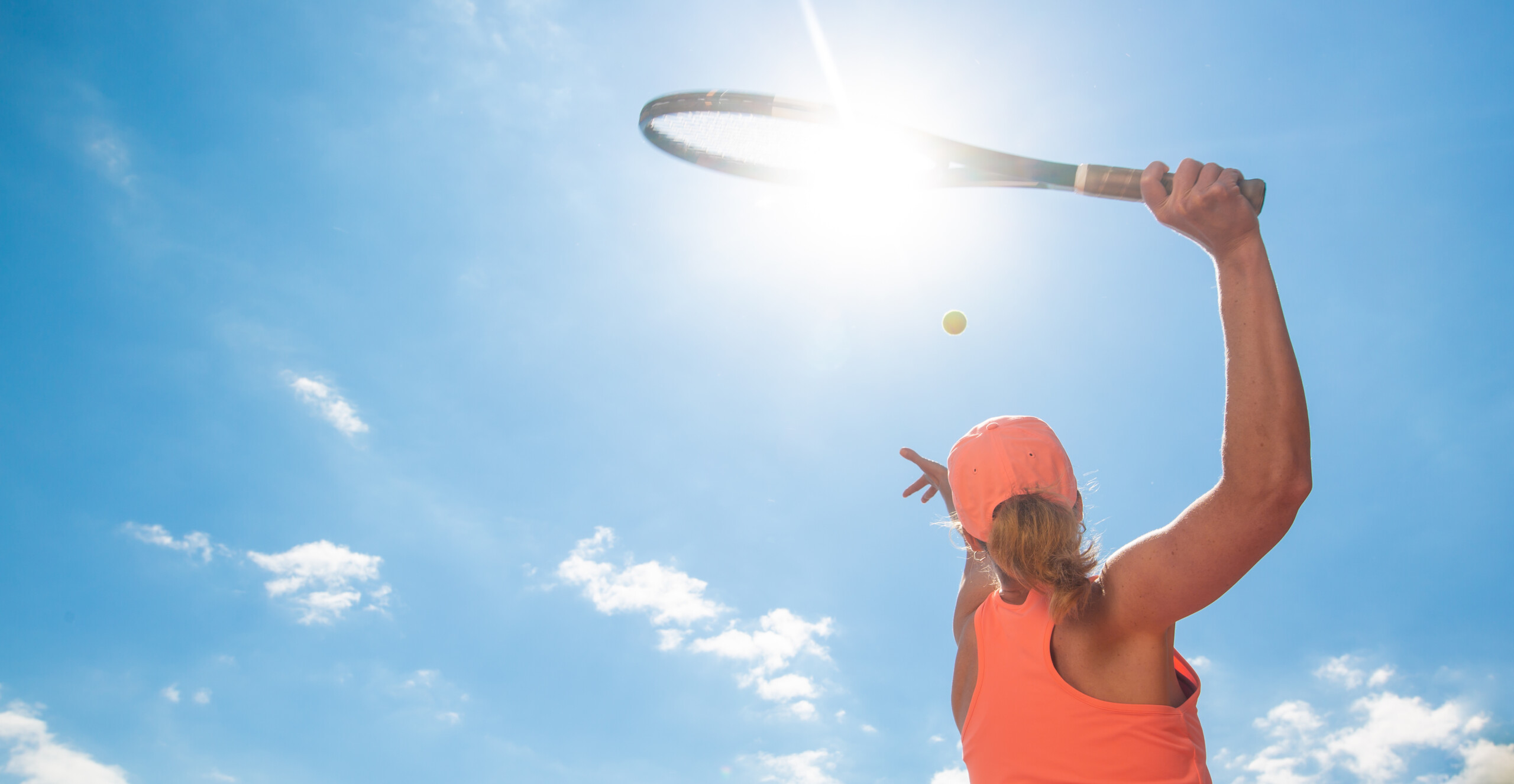 Professional tennis woman player in action playing tennis in tennis court outdoor, sport concept, copyspace