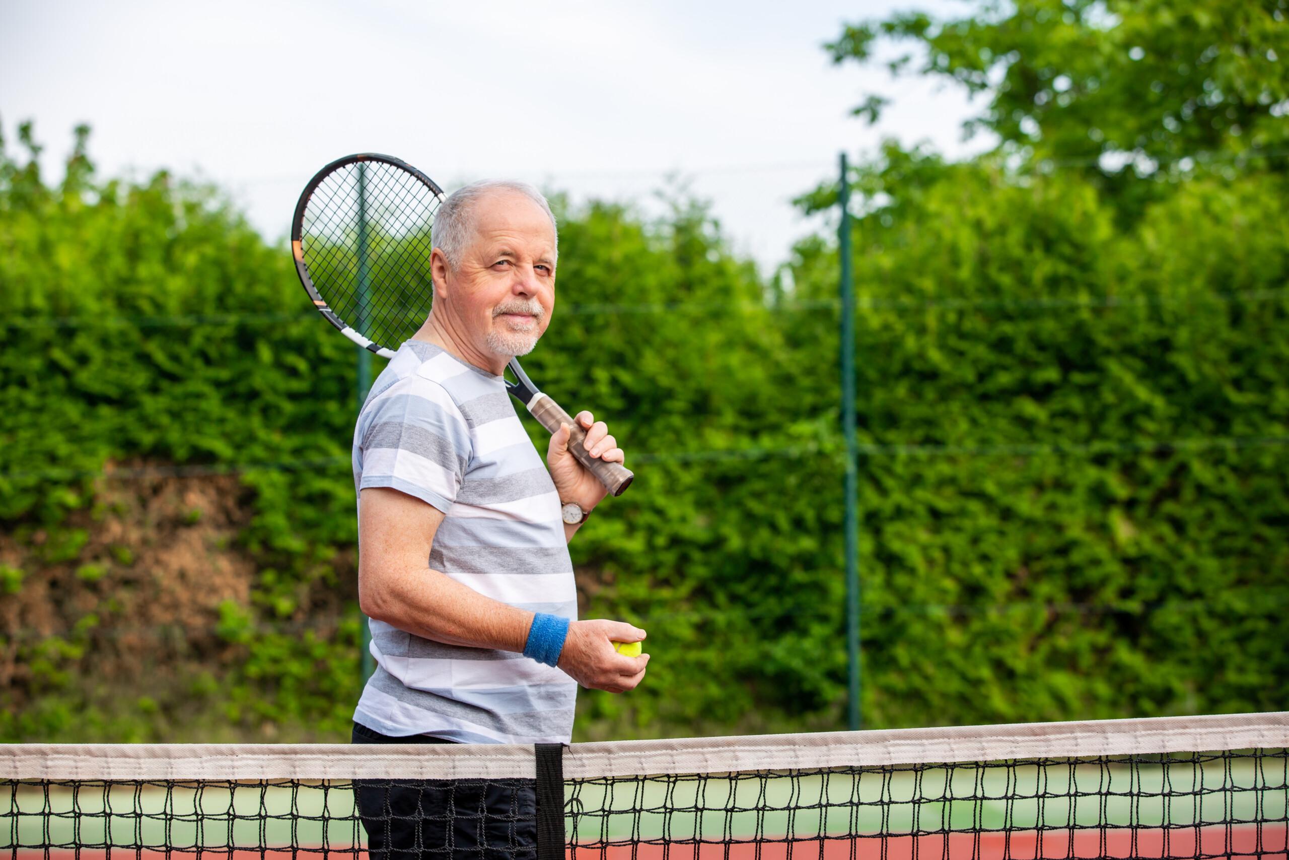 Portrait of senior man before his tennis match, sport concept