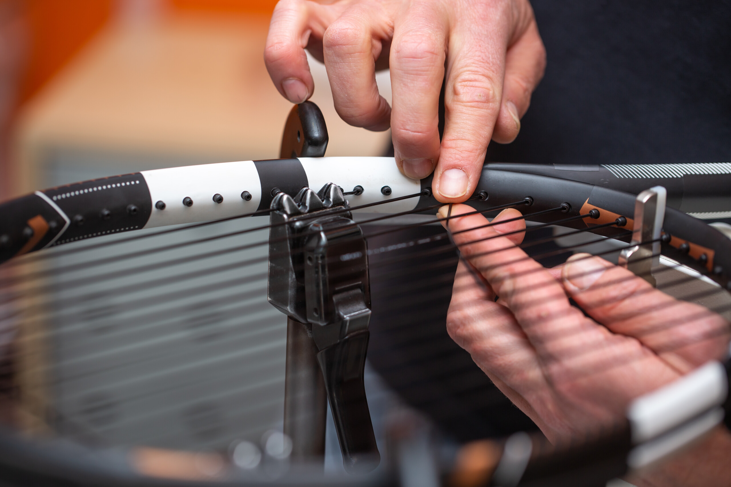 Process of stringing a tennis racket in tennis shop, sport and leisure concept