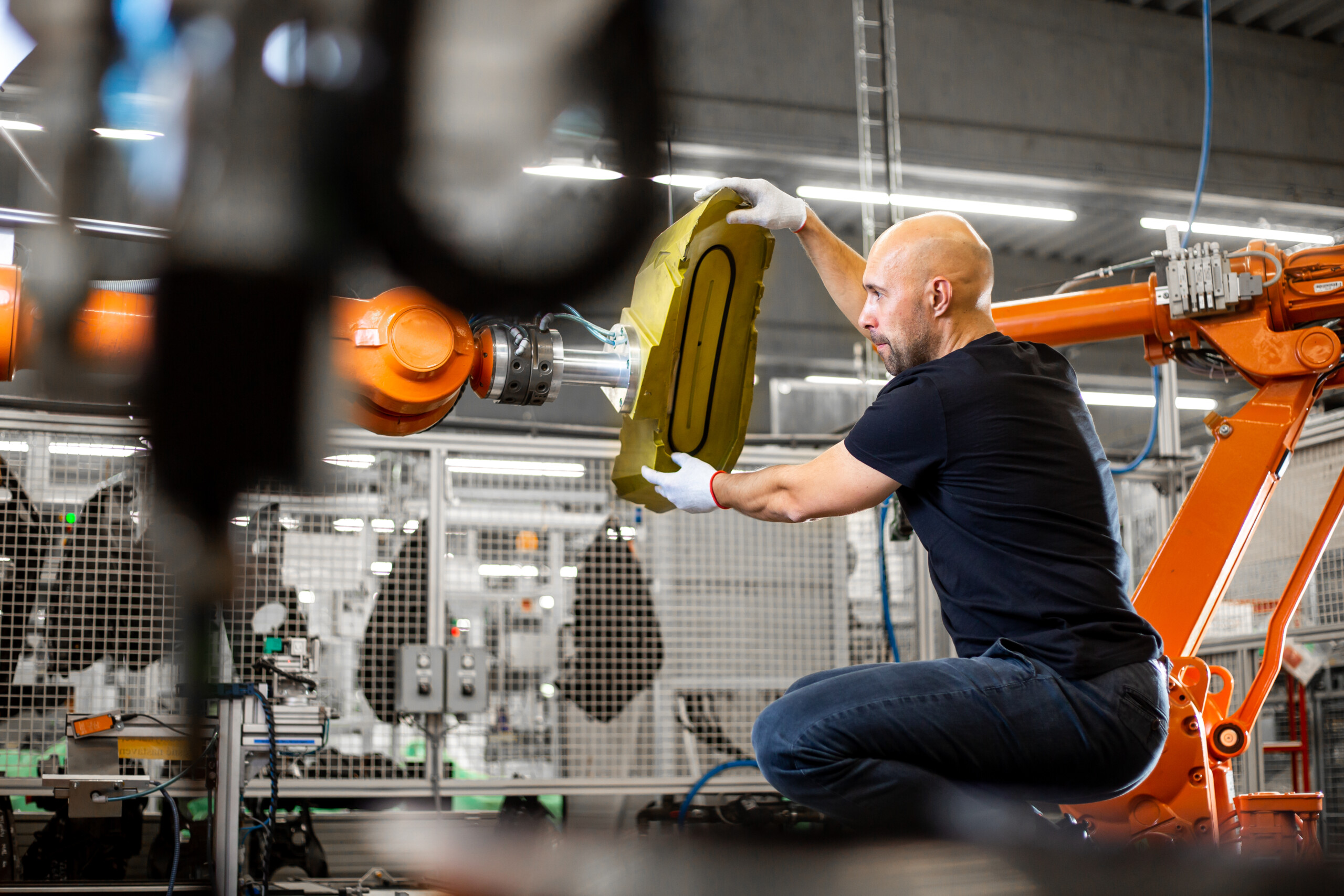 Engineer repairing an automatic robot amrs in automotive, smart factory